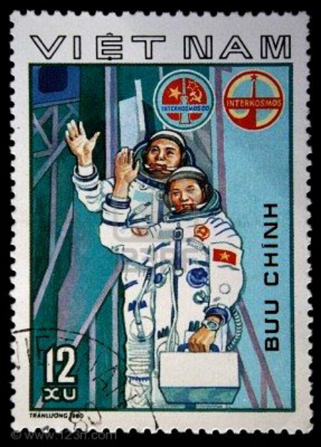 5575650-a-stamp-printed-in-vietnam-shows-vietnam-cosmonaut-ph--m-tu-n-and-soviet-cosmonaut-viktor-gorbatko-s